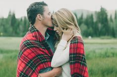 so cute to snuggle up in a blanket together!! blanket with engagements
