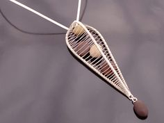 Pendant   Tana Acton.  Sterling silver and 5 pebbles