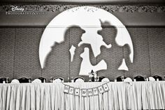 A Cinderella and Prince Charming gobo light brought some glamour to this Disney reception #Disney #wedding #Cinderella #gobo