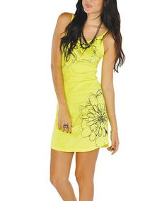 Like fresh-squeezed lemonade, this fun and feminine piece suits scorching, sunny days. Flowers decorate the neon silhouette, creating a casual-chic frock that's totally resort-ready.