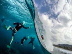 sonsofkerouac:    The guys at work in Hawaii, What a fantastic angle. Surfer: Billy Kemper. Photo by Sash Fitzsimmons. — with Adriano Camilo Alves, Fredy Alejandreo Rodriguez Rodas and Mehdi Khammouri.  Via: Wavelength Mag
