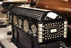 Casket made with dollar bills and coins. Dude wanted to prove you CAN take it with you, I guess.