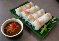 Goi Cuon.... These light and healthy fresh spring rolls are a wholesome choice when you've been indulging in too much of the fried food in Vietnam.  The translucent parcels are first packed with salad greens, a slither of meat or seafood and a layer of coriander, before being neatly rolled and dunked in Vietnam's favorite condiment – fish sauce.