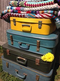 vintage suitcases and crocheted blankets