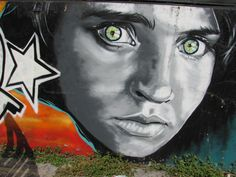 Street Art in Gernika, Spain. I remember her photo on the cover of Nat. Geo. when I was a girl. Just love this...
