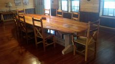 15 ft. diniing table and chairs built out of the sills from a historic property we deconstructed.  Table has original mortise and tennon joints that once held the house together.  No hardware used on the table.  (piece sticking up in middle of table w/ original wooden plug is and was how the table and house are held together in a number of places).
