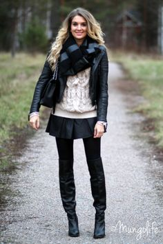 I like the mix of the chunky knit with the textured black leather.