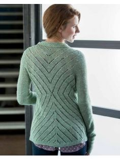 A drape-rich linen blend makes the perfect base for this relaxed knit cardigan pattern with it's stripped-down styling and expansive lace pattern at the back.