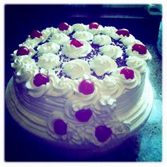 Black Forest cherry cake with whipped cream, cherries, and chocolate shavings.