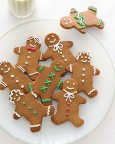 Adorable spiced gingerbread people make the rounds on Christmas dinner menu—don't let this year be the exception. #traditionalchristmasdinner #holidaydinnermenu #classicchristmasdessertideas #familydinner #bhg
