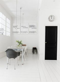 A black and white dining area, seen via Emma's Design Blogg.