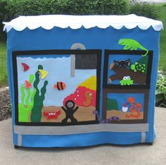 Here is a card table playhouse for our pet lovers! This colorful Pet Shop Playhouse comes with 8 removable/replaceable fish, 4 letters for the mailbox and a matching storage bag. Your playhouse will h More