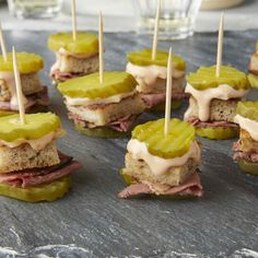 Reuben Pickle Bites This pickle-on-a-stick appetizer has all the flavors of a classic Reuben sandwich in one small bite. Watch this crowd-pleasing no-cook appetizer disappear in a snap at a party, game-watch or tailgate. No Cook Appetizers, Finger Food Appetizers, Appetizers For Party, Finger Foods, Appetizer Recipes, Tailgate Appetizers, Healthy Appetizers, Irish Appetizers, Sandwich Appetizers