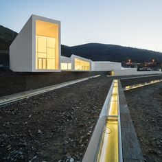 Rowing facility by Álvaro Fernandes Andrade snakes across a landscape of underground dorms