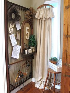 A canvas drop cloth, a coat hanger and some clothespins make this window treatment not only inexpensive but super easy to make. Donna from Funky Junk Interiors draped a drop cloth over a coat hanger and clipped it into place with clothespins. The hook of the coat hanger simply balances on the window trim for a fun, whimsical look.