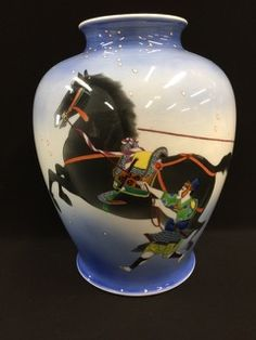 SUPERB EARLY 1900S JAPANESE FUKAGAWA PORCELAIN HAND PAINTED VASE DEPICTING A MAN AND WOMAN TRYING TO TAME A HORSE. THE VASE MEASURES 12 INCHES IN HEIGHT BY 9 INCHES AT THE WIDEST POINT. THERE IS A BIT OF ENAMEL LOSS FOUND THROUGHOUT THE IMAGE BUT OTHERWISE A SOLID PIECE