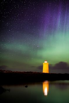 Aurora borealis at Hólmbergs lighthouse by Gunnar Gestur. Iceland