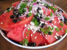 Watermelon Salad, with black olives, red onion and vinaigrette.  Great for a picnic or pot luck