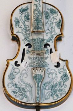 SZASZ ENDRE FULL SIZE PORCELAIN VIOLIN: 20th century. Modern Hungarian green and white glazed porcelain full size violin with parcel gilt decoration.