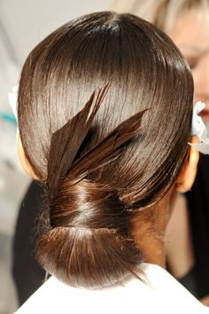 chignon, doubled up and wrapped pony, with feathers