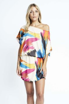 Karen Zambos' best selling style in exclusive online prints. A boat neckline and short batwing sleeves accentuate the airy cut of this Karen Zambos dress. Hidden elastic defines the waist. Lined. Fabr