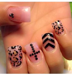 Nail design: pink and black with cross and leopard