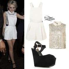 Perrie, along with two other of the Little Mix girls wore a white coloured outfit. She wore a Topshop Sequin and Flower Shirt ($96.00) with a Topshop Dungaree Playsuit ($84.00). She also wore a pair of Kurt Geiger Garfield Wedges (£220).