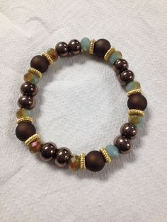 Mix of Browns and SeaGreen Rondelle Stretch Bracelet made by Atta Girl Sten