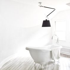 Artemide Tolomeo + Clawfoot tub