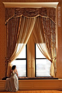 This is from yesterday's shoot at the Pfister.  Just an amazing location with an amazing model!      It's days like this that I especially love being a photographer!    Pfister, pageant girl, silver dress, gold, large windows, curtains, drama, dramatic, beauty, Milwaukee photographer, hotel, LotusFly Photography #viewbug