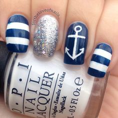 Navy blue and white stripes, one nail navy blue with white anchor, and a sliver nail.