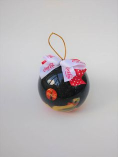 Check out this item in my Etsy shop https://www.etsy.com/listing/565462033/coca-cola-christmas-ornament-coca-cola