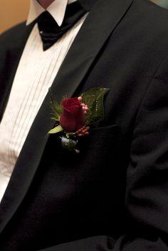 My husband's matching red rose buttonhole