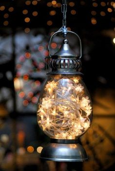 DIY Garden Light...Hang a lantern filled with a strand of twinkle lights. Surprisingly bright, & it reminds me of fireflies. :)