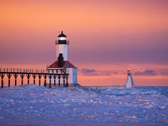 St. Joseph Lighthouses, Michigan The St. Joseph Lighthouses attempt to withstand the elements on frozen Lake Michigan. The 2 lighthouses were built in the early 1900s, and the outer light is one of the oldest on the lake.