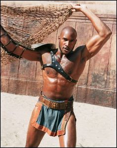 "Actor Henry Simmons as gladiator slave Draba appears in this scene from USA Network's ""Spartacus,"" in this undated publicity photo. The four-hour miniseries, an adaptation of Howard Fast's historically inspired novel about a slave revolution against the Roman empire, airs Sunday, April 18, 2004 - April, 19 at 8 p.m. ."