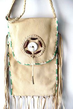 American Indian buck skin tan leather pouch w/bead work. (ITEM - M46)