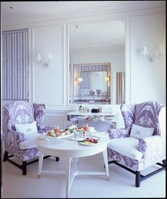 Monogram pillows in chair.... digging the purple!
