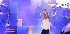Harry Styles spitting water GIF -Sugarscape.com