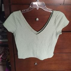 crop top light green, mint condition, double v-neck front and back, tight but stretches to fit! Hollister Tops Crop Tops
