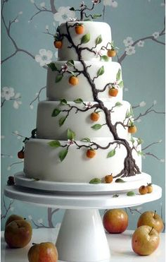 Or you could use the seasons to inspire your wedding cake decoration, like this apple-decorated cake by Planet Cake. Could be tree of life cake, or just a fantasy cake with a tree theme.