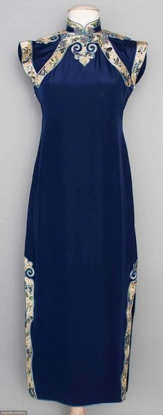 """EMBROIDERED SILK CHEONGSAM, CHINA, 1930s Sapphire blue silk faille w/ white butterfly & flower embroidered bands, padded frog closures, deep side slits, B 34"""", H 38"""", L 48"""", (loose gold threads in trim bands); t/w 1 pair blue silk trousers w/ metallic gold couched embroidered & 1 olive green wool lace cheongsam; excellent."""