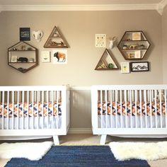 Modern geometric boho nursery for gender neutral twins. Navy, mustard, and pink.