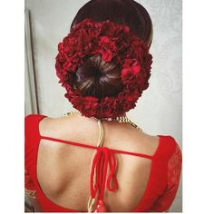 Don't be afraid to think outside the box. How gorgeous is this bun adorned with red florals instead of the classic jasmines? Indian Wedding Makeup, Wedding Day Makeup, Bridal Makeup Looks, Indian Bridal Makeup, Big Fat Indian Wedding, Bridal Looks, Indian Bridal Hairstyles, Bun Hairstyles, Bridal Bun