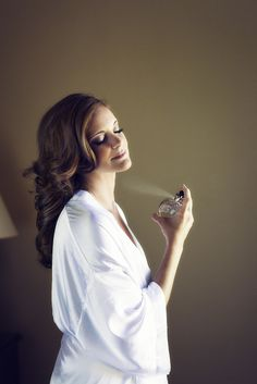 "Ideas for Wedding Day Beauty Photos - like this ""getting ready"" photo of the bride applying her favorite fragrance / PopSugar"