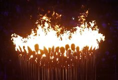 The Olympic cauldron burns after being lit during the Opening Ceremony at the 2012 Summer Olympics, Saturday, July 28, 2012.