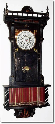 .1885, Sidney Advertising Clock Co., Sidney, New York, wall hanging time and calendar clock with separate movement for rotating the bottom drums every 5 minutes.