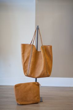 Awesome camel colored chain strap tote, with small cosmetic bag included.  Perfect to throw everything in and go!