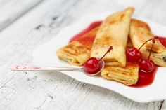 Cherry Crepes are easy to make with this simple recipe and easy to follow directions from All She Cooks. Crepe recipe can be used with a variety of ingredients and toppings.