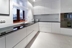 Modern/white kitchen cabinets.